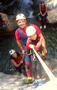 Canyoning in Benahavis, Costa del Sol Dad climbing with child
